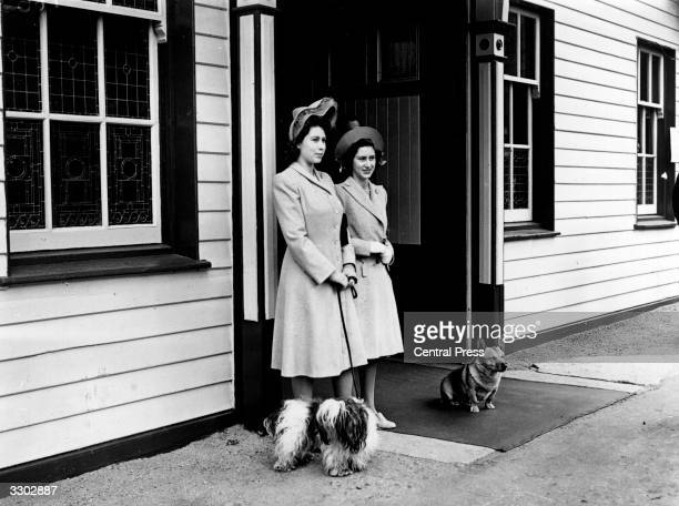 Princess Elizabeth and Princess Margaret Rose waiting at Ballater Station near Balmoral Castle Aberdeenshire with two dogs Queen Victoria's husband...