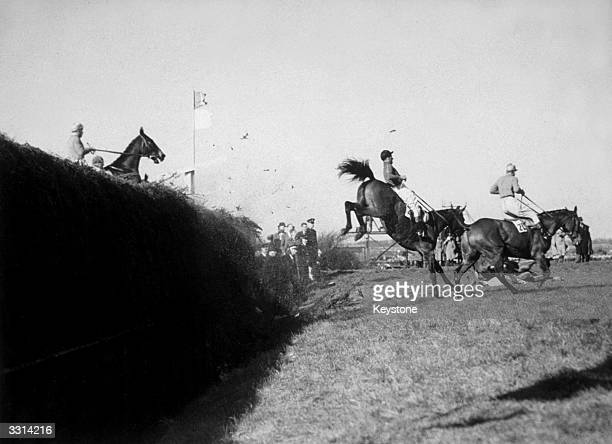 Several horses heading for a fall at Becher's Brook during the Grand National at Aintree Liverpool