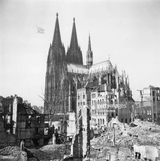 The twin spires of Cologne Cathedral stand remarkably unscathed amidst the city's other bomb damaged buildings