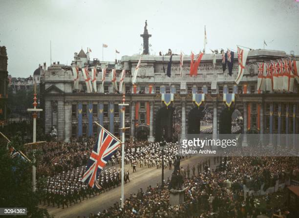 Troops passing under Admiralty Arch during a victory parade in London