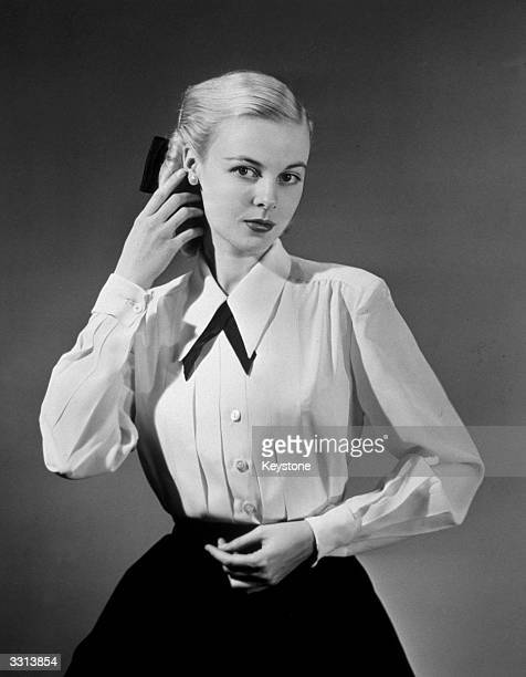 A model wearing a tailored classic blouse with pleats