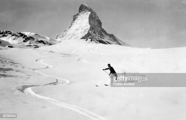 A skier makes his way down the slopes with the Matterhorn in the background