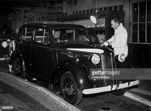 A Vauxhall 10 being driven off the assembly lines at the Vauxhall Motor Company in Luton