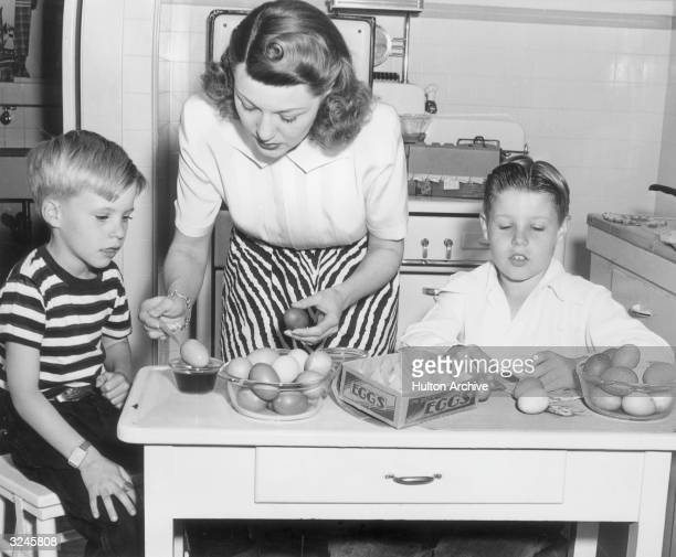 American actor Harriet Hilliard Nelson of the television show 'Ozzie and Harriet' shows her sons future singer Ricky Nelson and future director David...