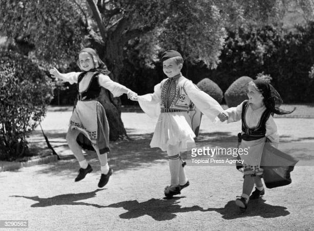 From left, Princess Sofia of Spain, , Crown Prince Constantine II of the Hellenes, , and Princess Irene of Greece, in the garden of their home in...