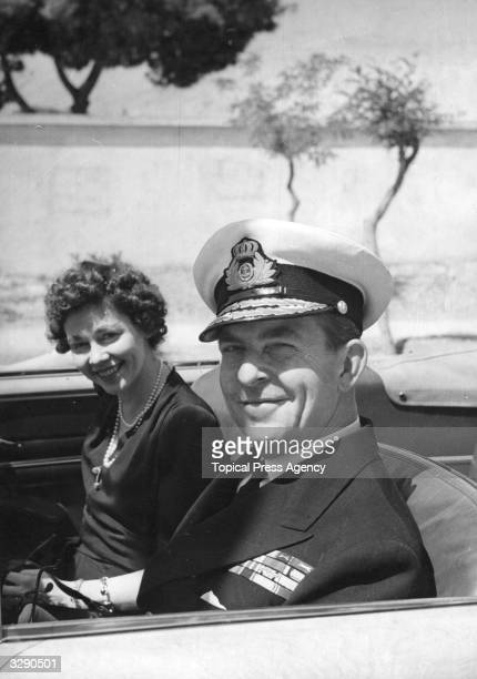 King Paul I of the Hellenes , King since 1947 with his wife Queen Frederika , setting off for the Palace in Athens from their suburban home, as they...
