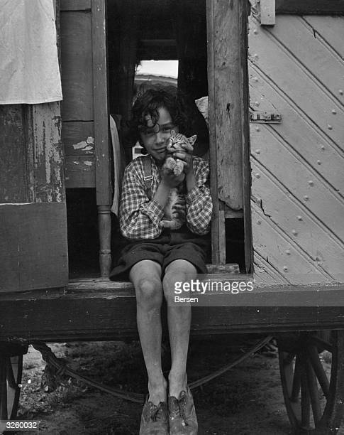 Lupa with his pet cat a very rare sight amongst the gypsy fraternity in Europe where every bit of food must be accounted for in human terms only