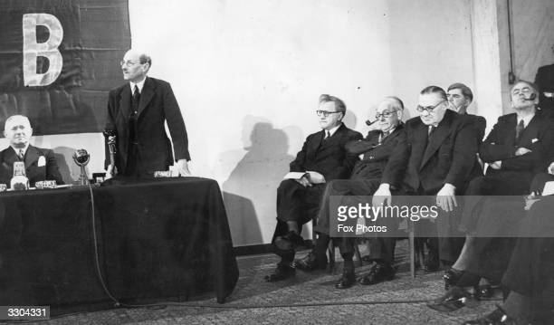The Labour Cabinet with left Emanuel Shinwell standing Prime Minister Clement Attlee seated left to right Herbert Morrison Arthur Greenwood Ernest...