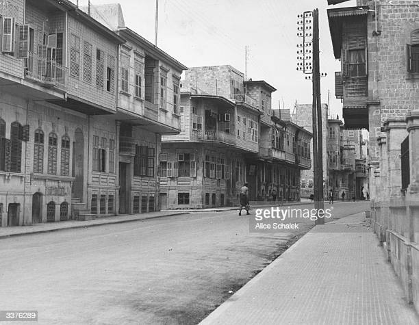A street in Aleppo Syria Although modern the houses are built in an ArabicSyrian style and retain features such as harem windows for the seclusion of...