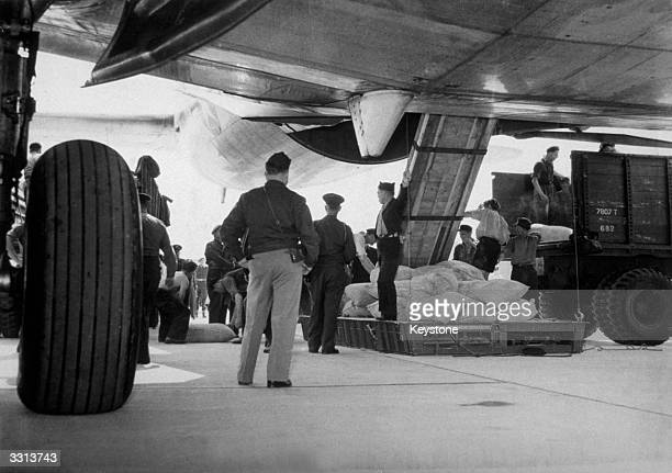 An American transport plane, taking part in the Berlin Airlift, at Gatow Airport having just landed with 23 tons of flour for the Berlin population,...