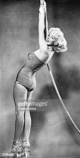 An early publicity shot of Marilyn Monroe .