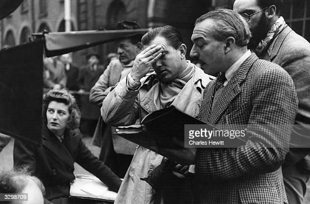 Canadian director Edward Dmytryk, who was forced into exile during the McCarthy witch-hunt puts his hand to his forehead as he goes over a...