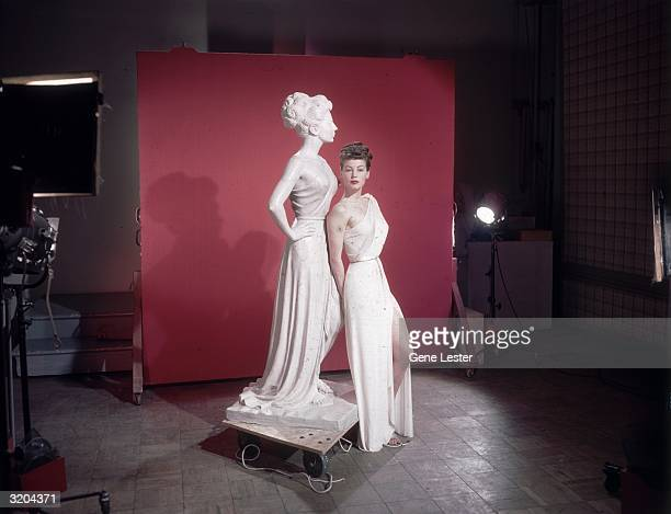 EXCLUSIVE Fulllength portrait of American actor Ava Gardner leaning on a statue of herself as Venus the Roman goddess of love on the set of director...