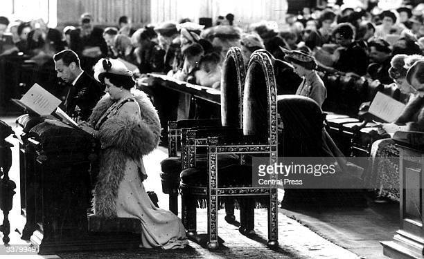 Queen Elizabeth and King George VI kneeling during a service held to commemorate their Silver Wedding anniversary at St Paul's Cathedral London