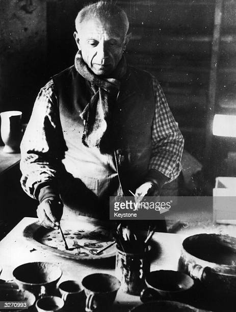 Spanish artist Pablo Picasso at work in his Mougins pottery works France