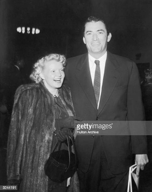 American actor Gregory Peck and his wife, Greta Rice, laugh as they arrive at a Friars Club event.