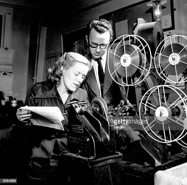 Betty E Box film producer of the 'Doctor' series at Pinewood studios reviewing some rushes She was married to producer Peter Rogers of Carry On fame
