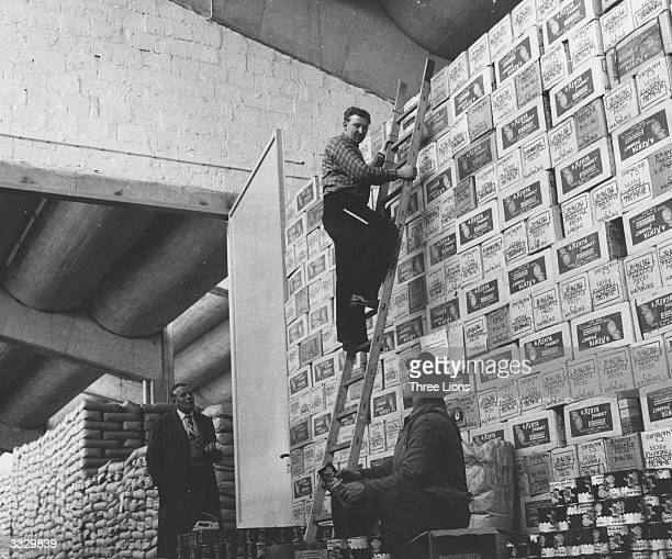 Boxes of pineapple and sacks of flour stacked up in a West Berlin warehouse during the Berlin Airlift in case of another Berlin blockade.