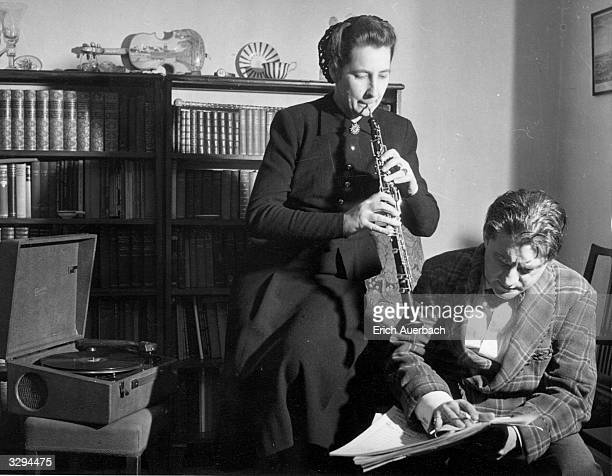 British conductor and cellist Sir John Barbirolli with his wife the oboist Lady Barbirolli, nee Evelyn Rothwell .