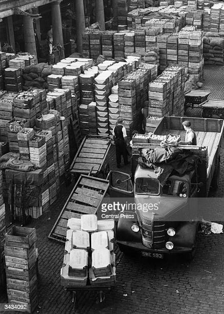 Crates of fresh fruit and vegetables arriving at Covent Garden Market in London by truck