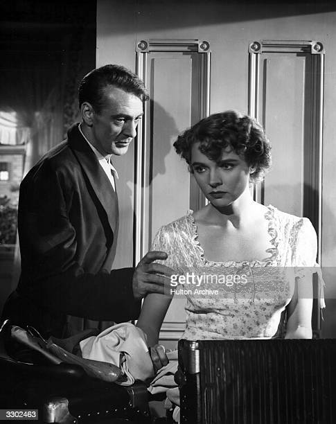 Jane Wyatt and Gary Cooper in an emotional scene from the film 'Task Force' directed by Jerry Wald for Warner