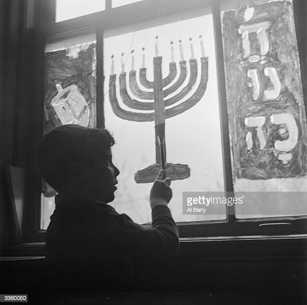 A Chanukkah window is decorated at the Hebrew Institute of Far Rockaway to mark the Jewish festival of light
