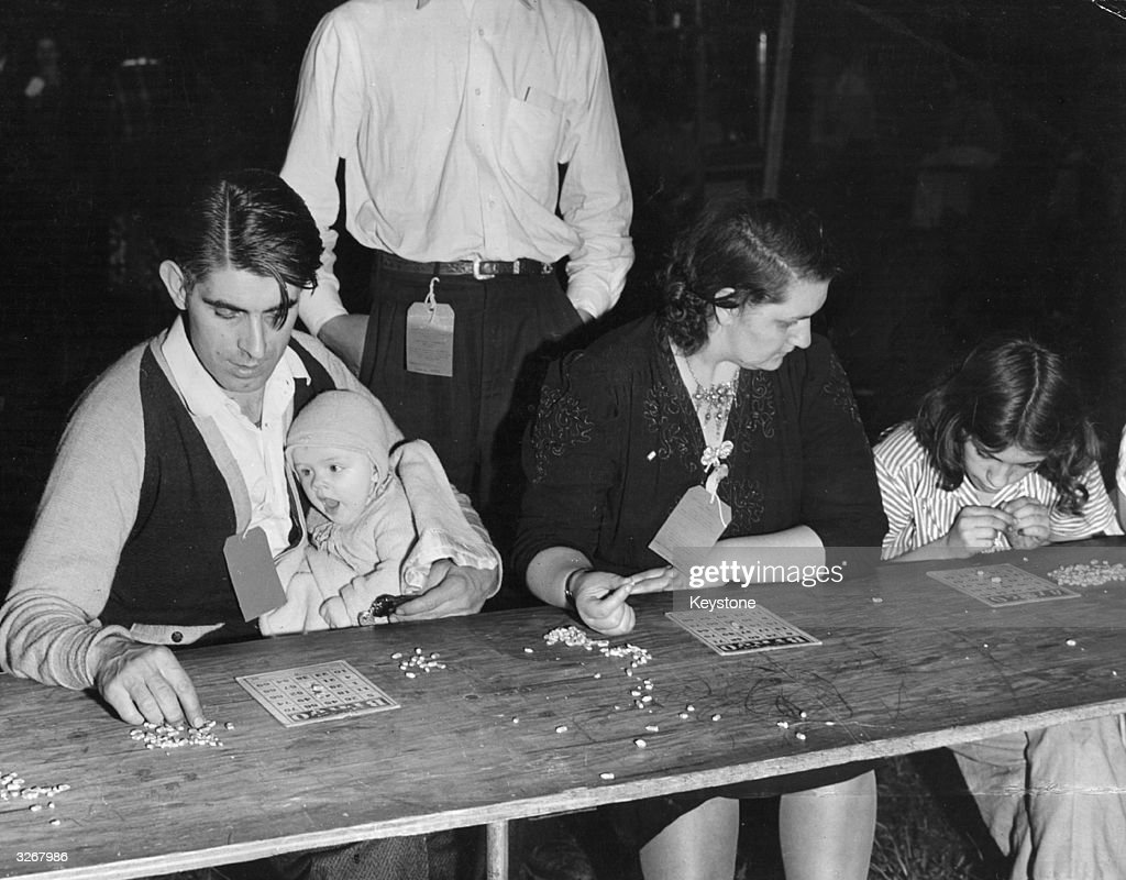 A family partakes in a game of Bingo.