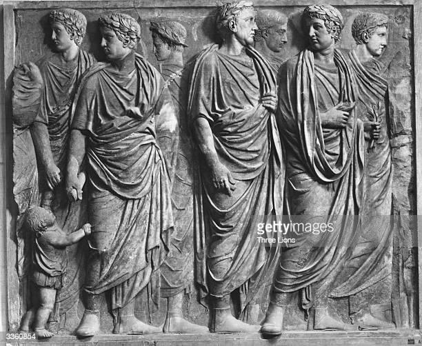 A fragment of a basrelief depicting Roman senators