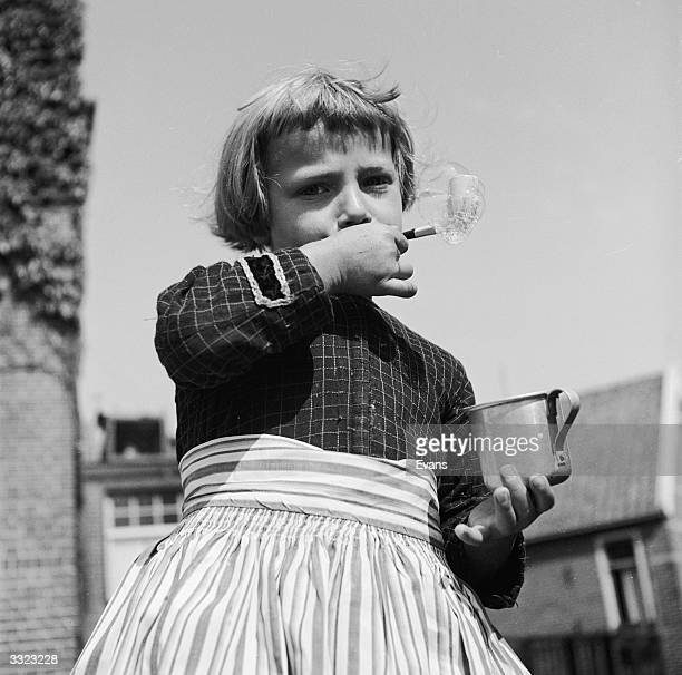 A girl blowing bubbles in the Dutch town of Volendam