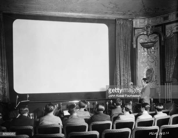 A group of boys attend a small movie screening to celebrate an MGM anniversary