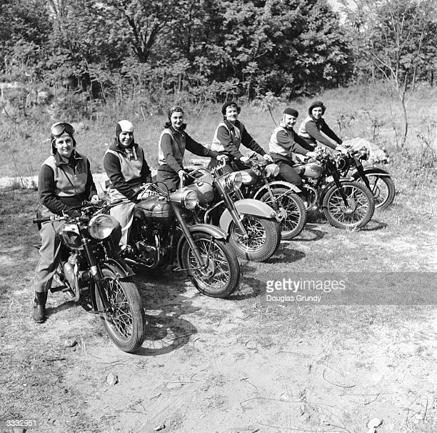 Group of women dubbed the 'Motor Maids of America' sit astride their motorcycles.