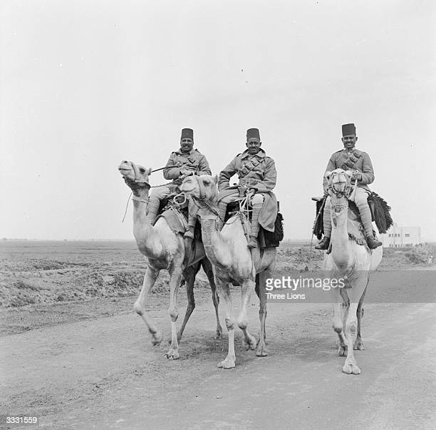 A military camel patrol on the road through the desert between Berber and Shendi in the Sudan
