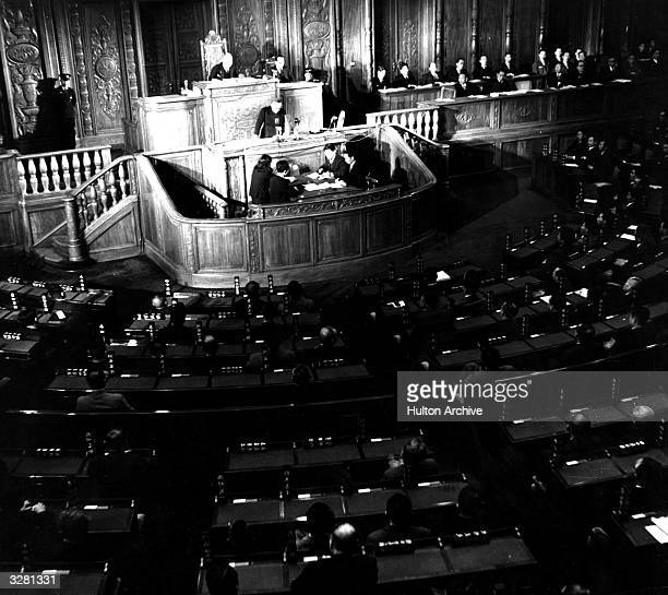 A photograph showing inside of the Imperial Diet with Shigeru Yoshida on the speakers platform with Kijuro Shidehara president of the House of...