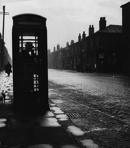 A public telephone booth in a Manchester street.