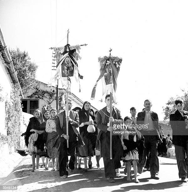 A religious procession moving through the town of Obidos in Portugal during the Feast of Ascension