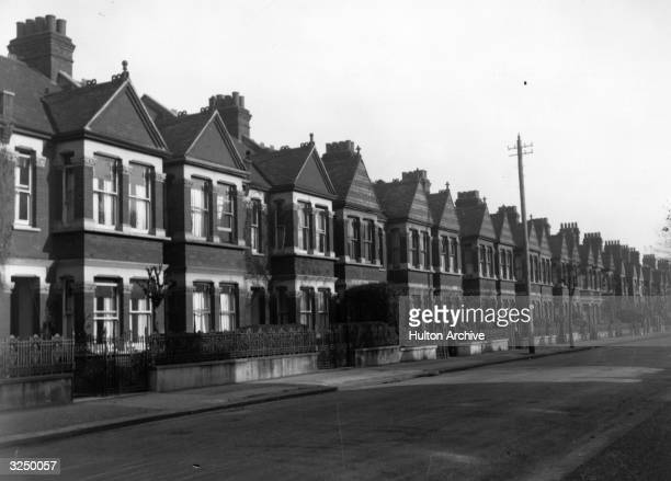 A row of terraced houses on a residential street in London