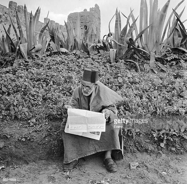 A school master studying near the ruins of the Chella near the Moroccan capital Rabat