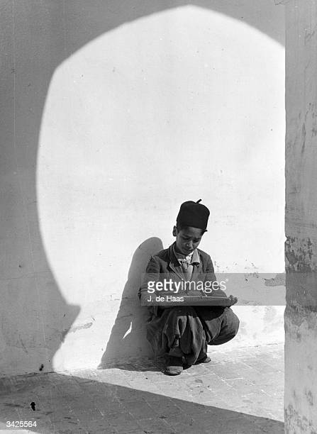 A schoolboy does some last minute reading before school starts in Morocco Africa