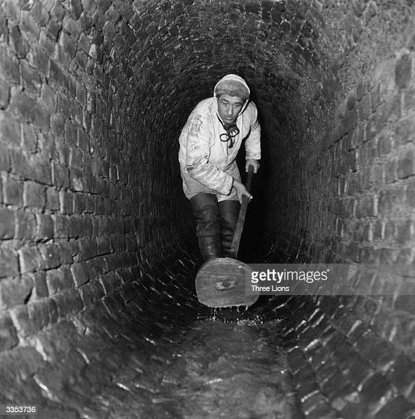 A sewer cleaner pushing water down a sewer in Vienna