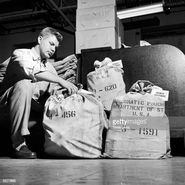 A state department worker seals a diplomatic bag containing government correspondence which will be sent to US embassies all round the world