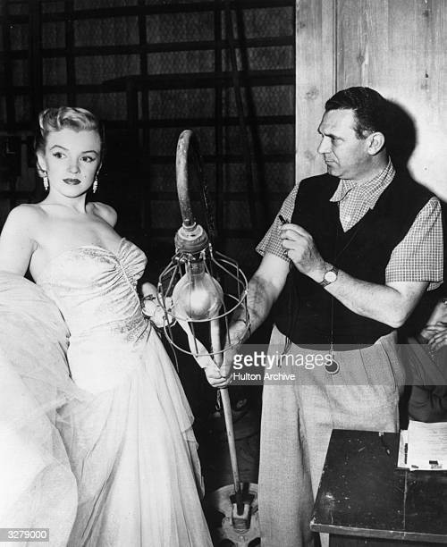 A technician checks the lighting for Marilyn Monroe during a rehearsal for her role in 'All About Eve' directed by Joseph L Mankiewicz for 20th...