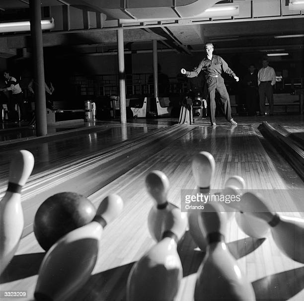 A tenpin bowler from Jamaica High School New York aiming for a strike