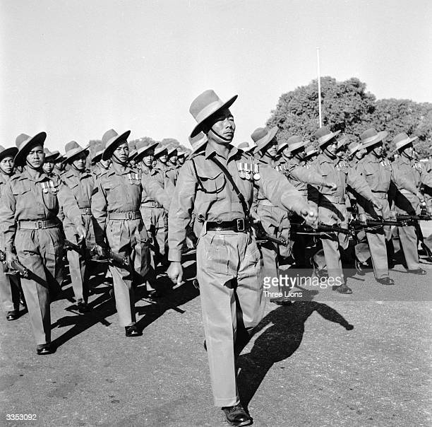 A troop of Nepalese Gurkhas marching in formation in India