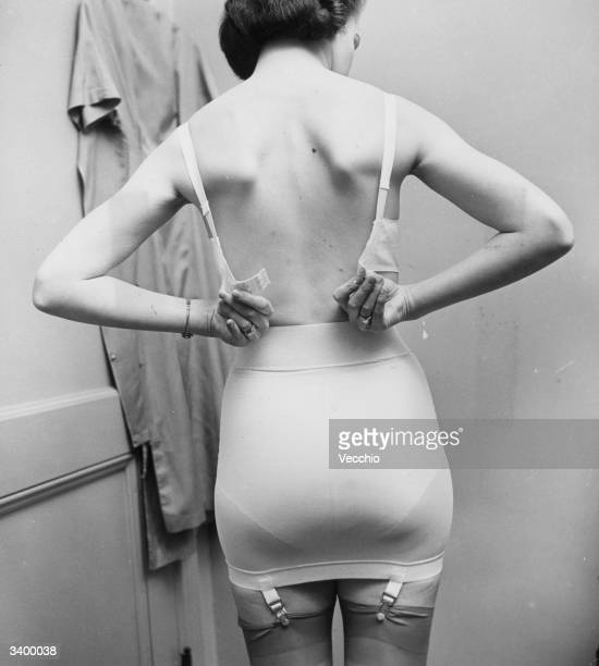 A woman fastening her bra