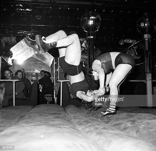 A woman threstler is thrown in a wrestling match during Hamburg's night time entertainment on the Reeperbahnstrasse