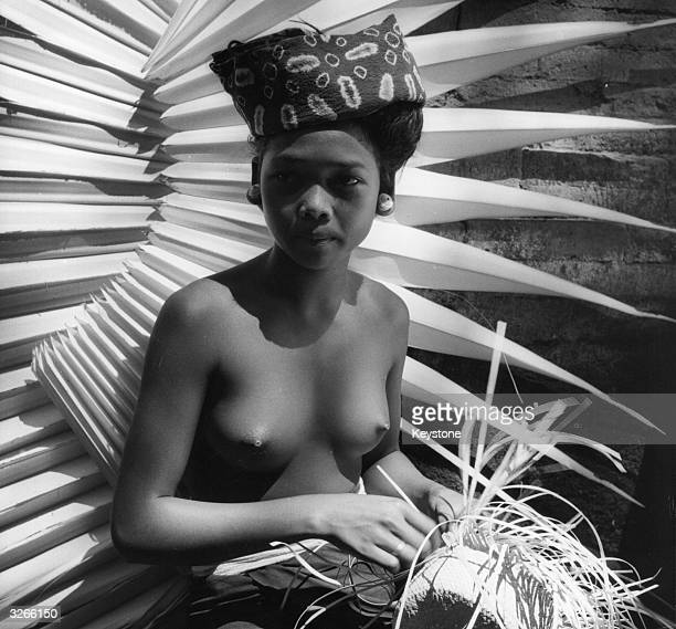 A young Balinese girl works at her weaving