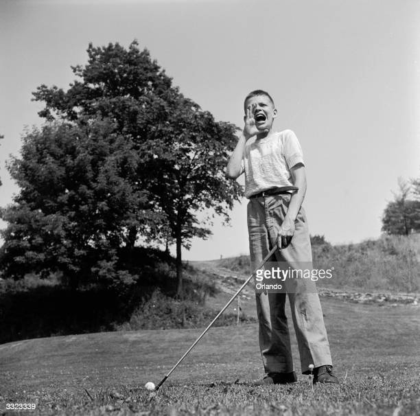 A young golfer shouts 'fore' at the Hershey Juvenile golf club Pennysylvania