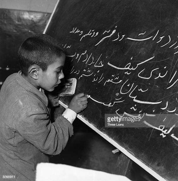 A young Iranian boy learns how to write