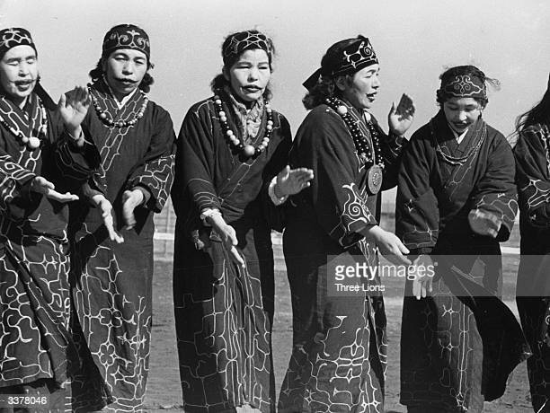 Ainu aboriginal people of Asia occupying parts of the Japanese island of Hokkaido Russian Kuril Islands and Sakhalin