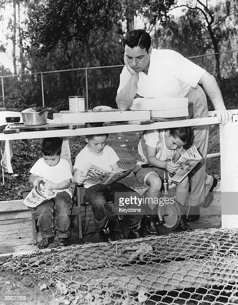 American bandleader Bob Crosby brother of singer and actor Bing relaxes with his sons